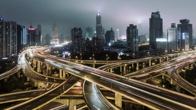 t/l pan aerial view of overpass and city traffic at night / shanghai, china - complexity stock videos & royalty-free footage