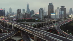 T/L PAN Aerial View of Overpass and City Traffic at Rush Hour, from Day to Night / Shanghai, China