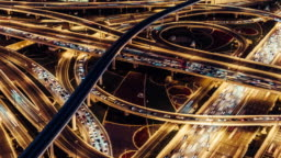 T/L ZO Aerial View of Overpass and City Traffic / Dubai, UAE