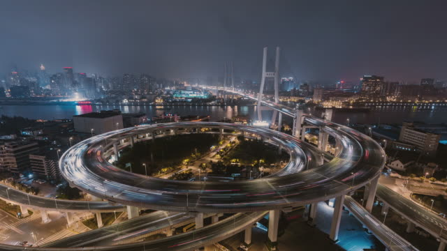 aerial view of overpass and city traffic / shanghai, china - cycle vehicle stock videos & royalty-free footage