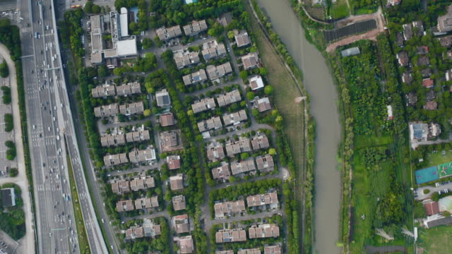 aerial view of overpass and residential community - liyao xie stock videos & royalty-free footage