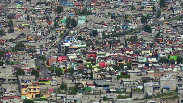 aerial view of overpopulation in mexico city. - slum stock videos & royalty-free footage
