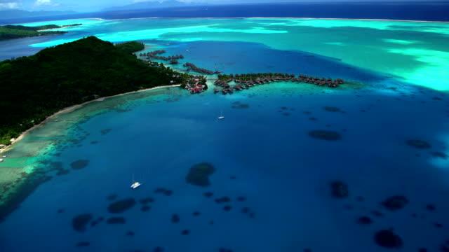 aerial view of overwater bungalow resort bora bora - polynesian ethnicity stock videos & royalty-free footage
