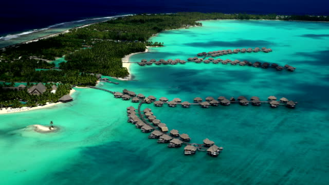 stockvideo's en b-roll-footage met aerial view of overwater bungalow resort bora bora - frans polynesië