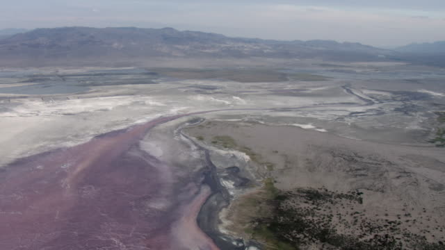 aerial view of owens lake and sierra nevada mountains, inyo county, california, united states of america. - lake bed stock videos & royalty-free footage