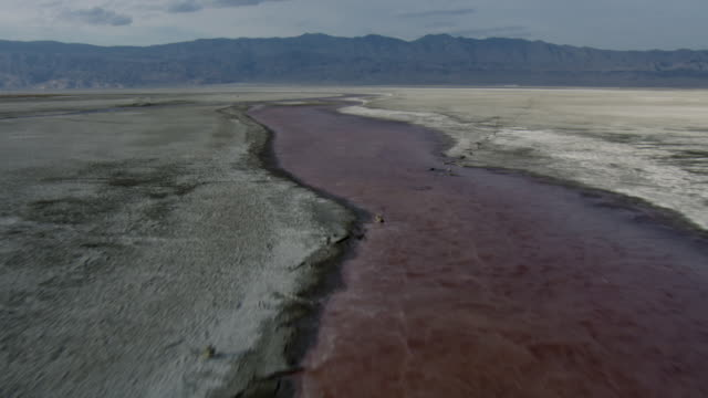 aerial view of owens river flowing through owens valley with view of sierra nevada mountains in california. - 1 minute or greater stock videos & royalty-free footage