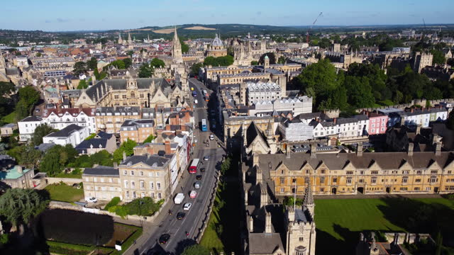 aerial view of oxford high street and magdalen college, oxford university. skyline of oxford behind. tracking shot. - oxford england stock videos & royalty-free footage