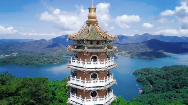 aerial view of pa cien pagoda in nantou, taiwan pacien pagoda, sun moon lake, nantou, taiwan - pagoda stock videos & royalty-free footage