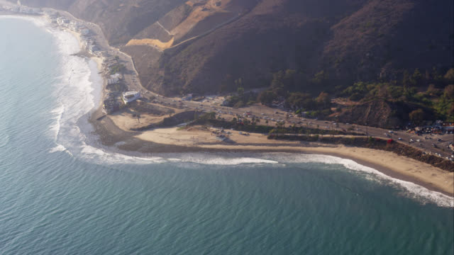 HA aerial view of Pacific Coast Highway and beach houses in Malibu, from the Topanga Canyon road intersection westward, RED R3D 4K, 4K, 4KMSTR