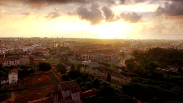 aerial view of palatine hill and coliseum at sunrise - rome italy stock videos and b-roll footage