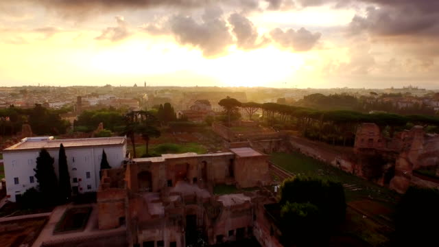 aerial view of palatine hill and coliseum at sunrise - rome italy stock videos & royalty-free footage