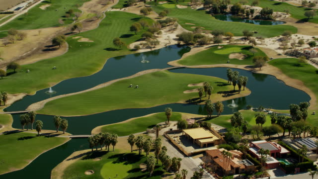aerial view of palm springs golf courses usa - palm springs california stock videos & royalty-free footage