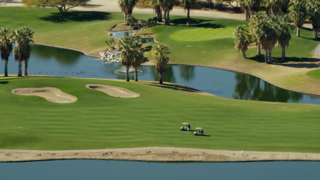 aerial view of palm springs golf courses usa - green golf course stock videos and b-roll footage