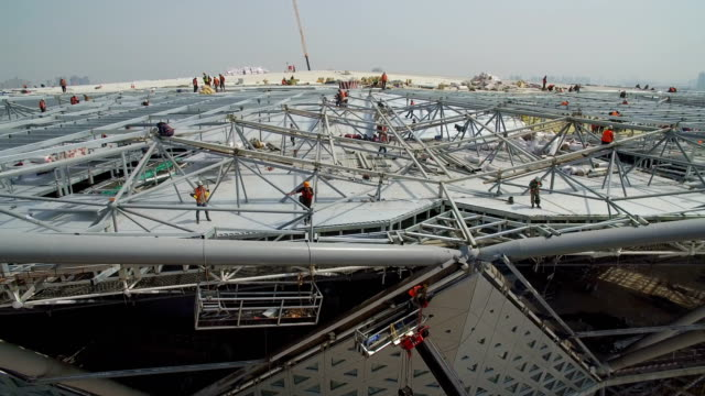 aerial view of panorama of the construction site of a huge stadium,xi'an,china. - balkengerüst stock-videos und b-roll-filmmaterial