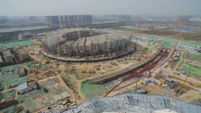 aerial view of panorama of the construction site of a huge stadium,xi'an,china. - concrete点の映像素材/bロール