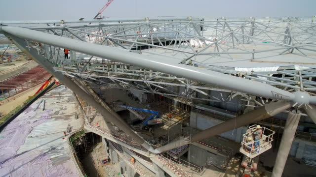 aerial view of panorama of the construction site of a huge stadium,xi'an,china. - steel stock-videos und b-roll-filmmaterial