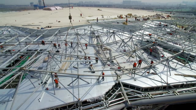 aerial view of panorama of the construction site of a huge stadium,xi'an,china. - bauen stock-videos und b-roll-filmmaterial