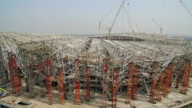 aerial view of panorama of the construction site of a huge stadium,xi'an,china. - building activity stock videos & royalty-free footage