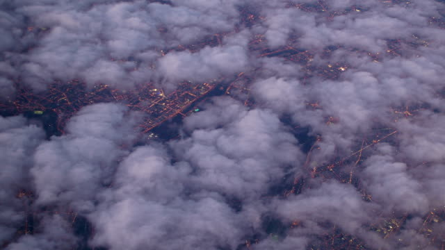 Aerial View of Paris Through Clouds at Sunset