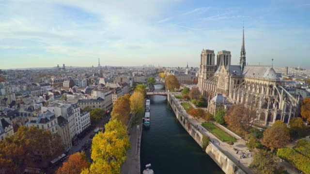aerial view of paris with notre dame cathedral - europe stock videos & royalty-free footage