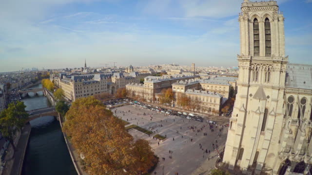 aerial view of paris with notre dame cathedral - notre dame de paris stock videos and b-roll footage