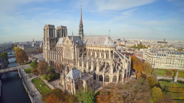 aerial view of paris with notre dame cathedral - cathedral stock videos & royalty-free footage