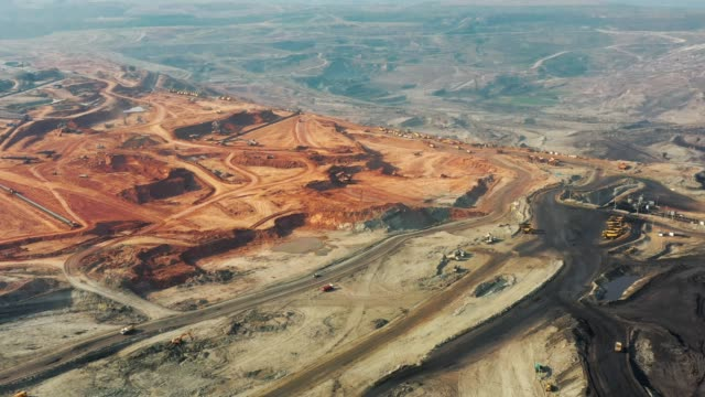 aerial view of part of a pit with big mining truck working, loading bulldozer in open air quarry - coal mine stock videos & royalty-free footage