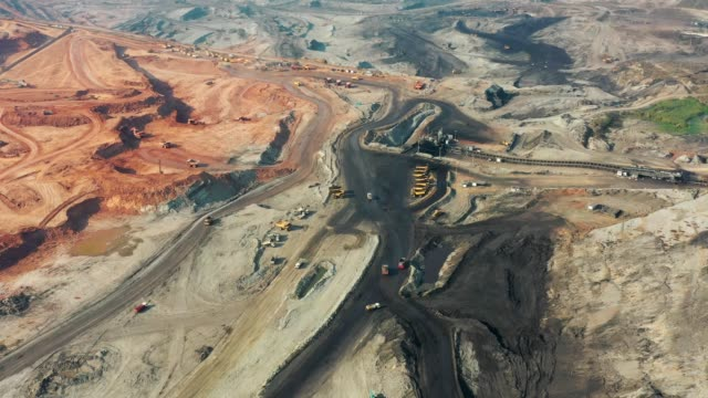 aerial view of part of a pit with big mining truck working, loading bulldozer in open air quarry - conveyor belt stock videos & royalty-free footage