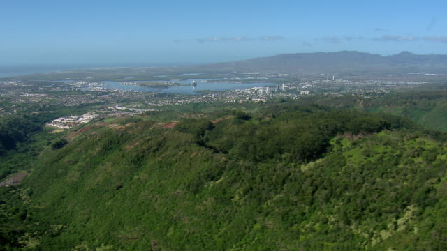 Aerial view of Pearl Harbor, seen in the distance on Oahu's leeward coast.