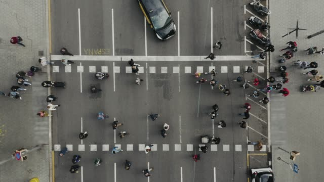 aerial view of pedestrians walking across. - crossing stock videos & royalty-free footage