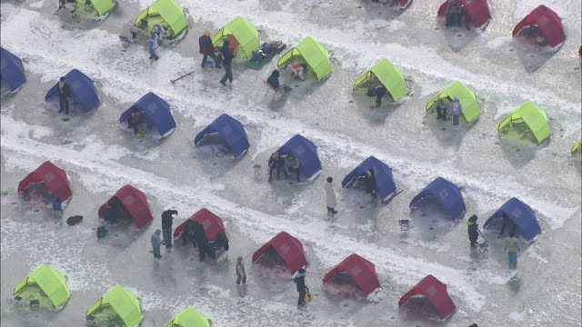 Aerial View of people enjoying ice fishing at Trout Catching Festival in Pyeongchang