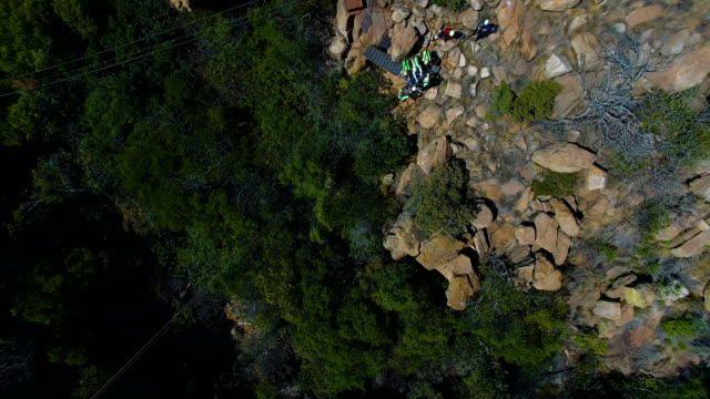 aerial view of people enjoying zipline, johannesburg, south africa - ロープスライダー点の映像素材/bロール