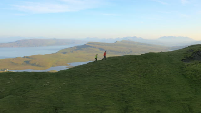aerial view of people hill walking trotternish ridge - schottisches hochland stock-videos und b-roll-filmmaterial