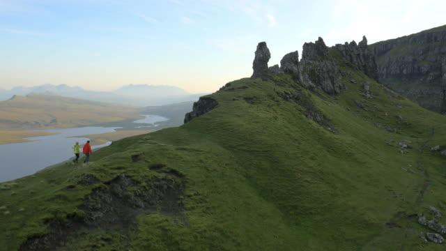 aerial view of people hill walking trotternish ridge - hebriderna bildbanksvideor och videomaterial från bakom kulisserna