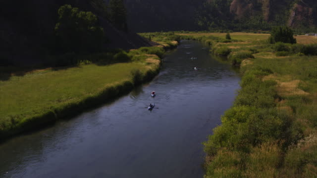 Aerial view of people kayaking in winding river / Afton, Wyoming, United States