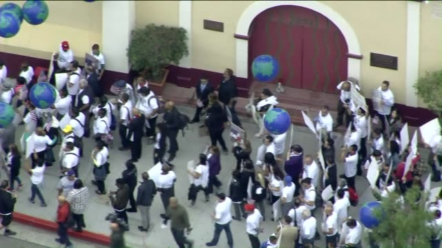 ktla aerial view of people marching for the 'vote to end hate' campaign on may 5 2016 - protestor stock videos & royalty-free footage