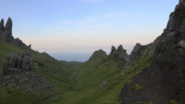 aerial view of people near old man scotland - schottisches hochland stock-videos und b-roll-filmmaterial