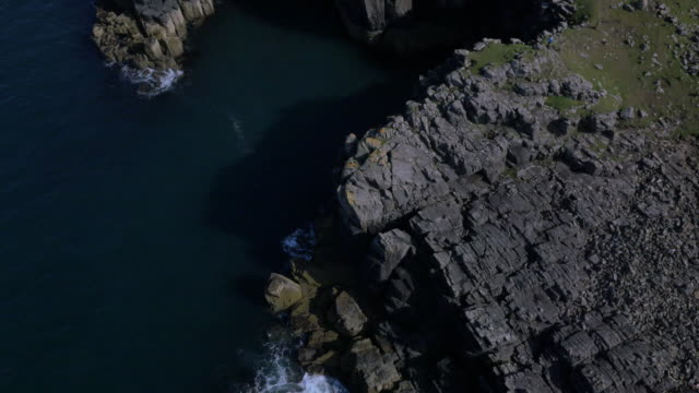 Aerial view of people Neist Lighthouse Scotland