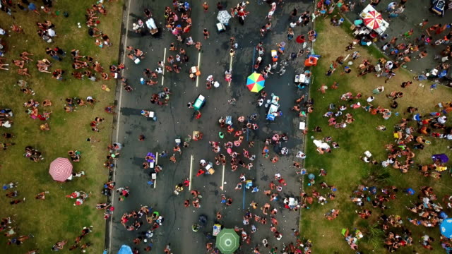 Aerial view of people out on the streets celebrating Carnival in Rio de Janeiro Brazil