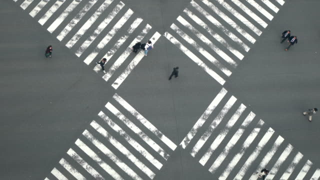aerial view of people passing crosswalk in the downtown street. - square composition stock videos & royalty-free footage