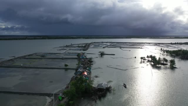 aerial view of people taking shelter on embankments in coastal areas. embankments have collapsed due to tidal surges in bangladesh on august 20,... - island stock videos & royalty-free footage