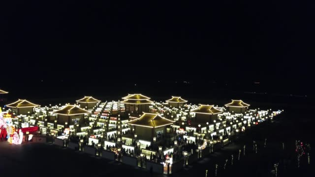 aerial view of people visit the winding yellow river lamp array, a temporary maze installation for the locals to go through to get a good omen in the... - fortune telling stock videos & royalty-free footage