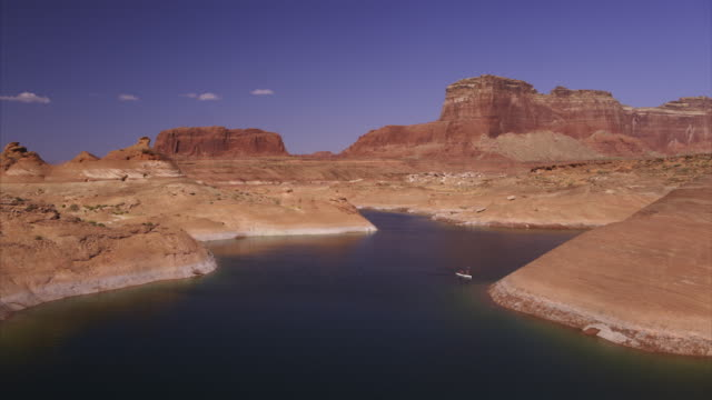 aerial view of person paddleboarding in lake / lake powell, arizona, united states - lake powell stock videos & royalty-free footage