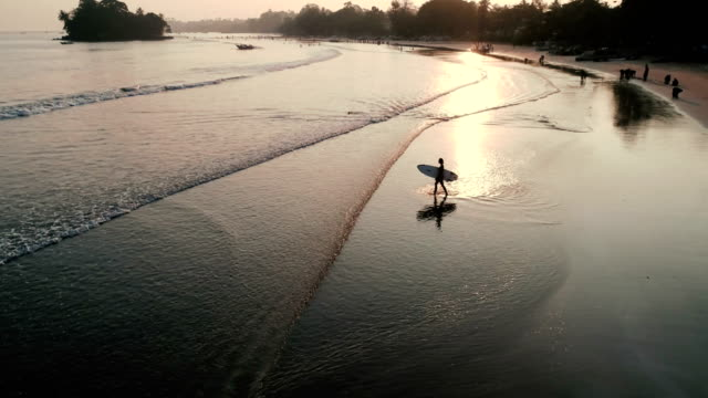 aerial view of person surfing in the ocean - sri lanka stock videos and b-roll footage