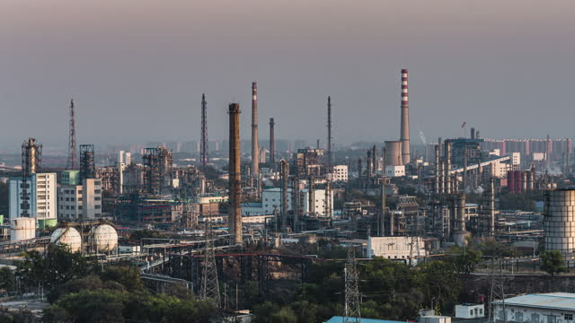 t/l pan aerial view of petrochemical plant and oil refinery industry, from day to sunset - day to sunset stock videos & royalty-free footage