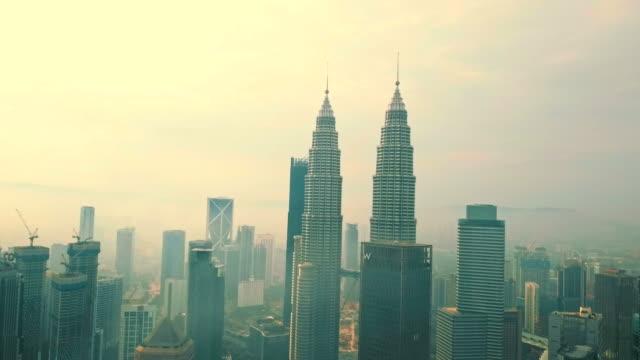 aerial view of petronas towers - kuala lumpur - malaysia - menara kuala lumpur tower stock videos & royalty-free footage