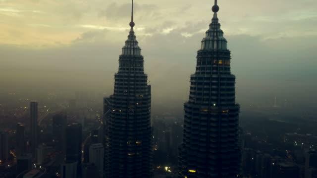 aerial view of petronas towers - kuala lumpur - malaysia - kuala lumpur stock videos & royalty-free footage