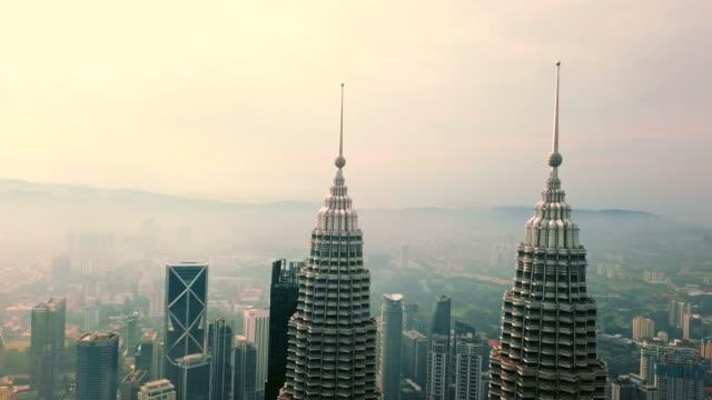 aerial view of petronas towers - kuala lumpur - malaysia - petronas twin towers stock videos & royalty-free footage