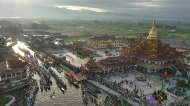 aerial view of phaungdawoo pagoda and boat in inle lake - myanmar stock videos & royalty-free footage