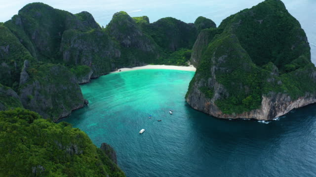 aerial view of phi phi le water bay, phi phi islands, thailand - phi phi le stock videos & royalty-free footage